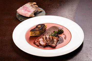 Veal cutlets with black pudding, potato cake with leek