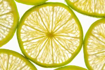 Fresh lemon fruit slices illuminated on white background