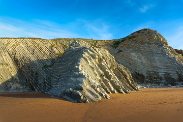 cliff of sedimentary rocks named flysch in Sopelana beach