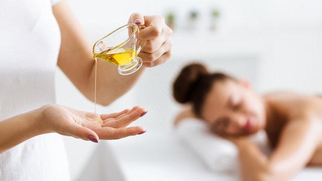 Masseur preparing for doing aromatherapy oil massage