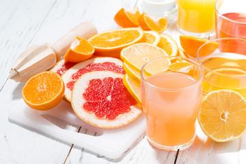 assortment of fresh citrus on a white board, closeup