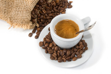 image of cup of coffee and coffee beans closeup