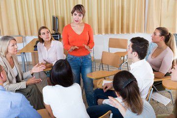 Girl talking to student group