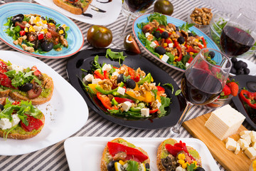 Vegetarian salads and sandwiches on dining table