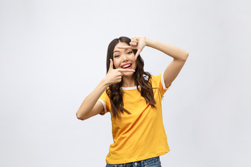 young asian woman hands making frame gesture on grey background