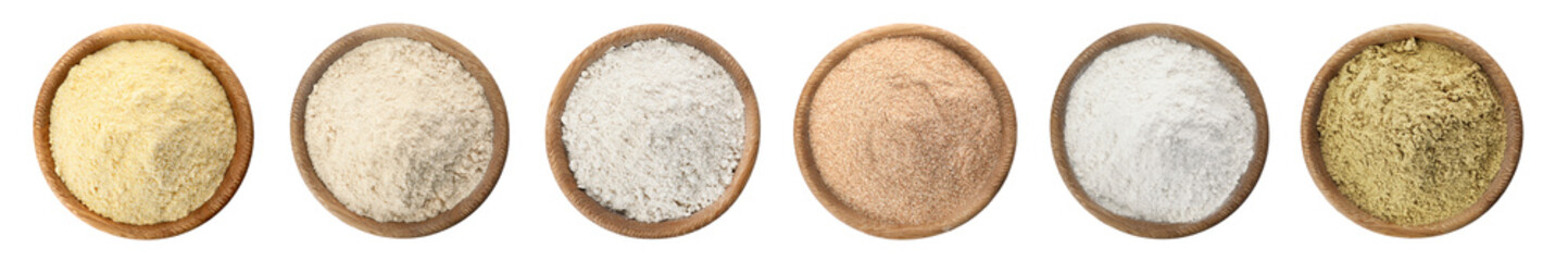 Set of organic flour in wooden bowls on white background, top view