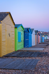 Beach huts in Hastings beach in the afternoon