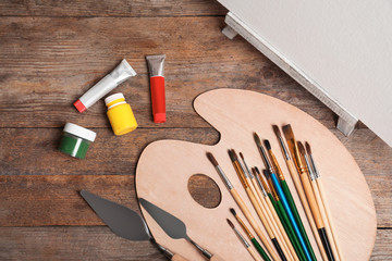Set of painting tools for children on wooden background, top view