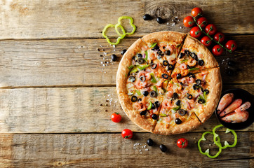 Pizza with shrimp, olives, green pepper and onion