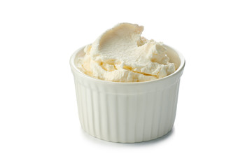 Fresh cream cheese in bowl on white