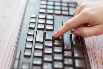 Woman presses the Enter key on the keyboard.