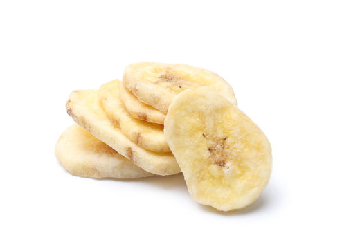 Sweet banana slices on white background. Dried fruit as healthy snack