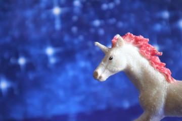magical unicorn on a blue backgroun