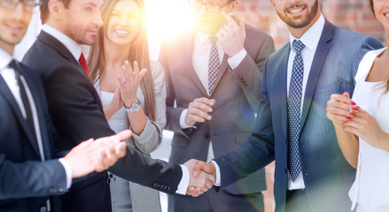 business shaking hands with business partner