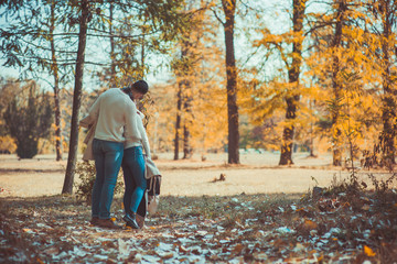 Romantic couple kissing in the wood