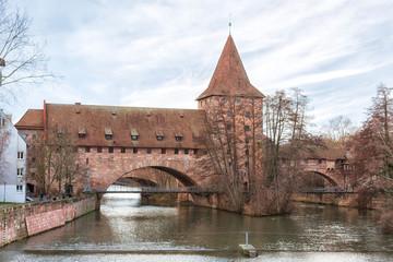 Nuremberg city, Germany - Schlayerturm medieval tower and Kettensteg (Chain Bridge) in winter