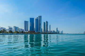 Abu Dhabi city skyline along Corniche beach taken from a boat