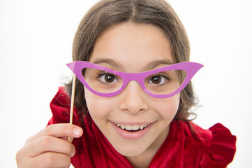 Kid happy wear eyeglasses photo booth props party accessory. Child cute smiling face with party accessory. All you need organize birthday party. Fun and entertainment. Girl hold eyeglasses for party