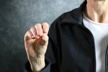 American Sign Language Letter O held in proper position next to body
