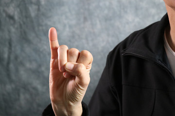 American Sign Language (ASL) letter I held in correct position next to body
