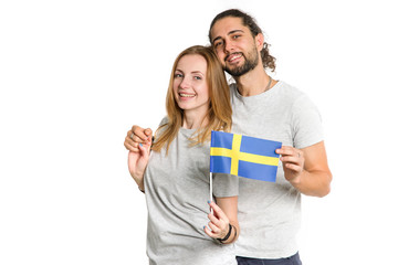 Couple, woman and man holding a flag of Sweden. Portrait Scandinavian people.