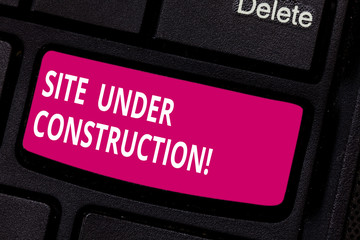 Writing note showing Site Under Construction. Business photo showcasing Implies something is being built for the first time Keyboard key Intention to create computer message pressing keypad idea
