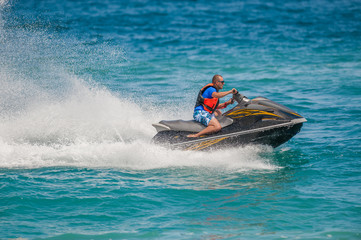Poster Nautique motorise Young Man on Jet Ski, Tropical Ocean, Vacation Concept