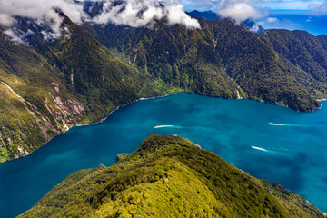 Poster Oceania New Zealand. Milford Sound (Piopiotahi) from above - the Sound's mouth on the right side