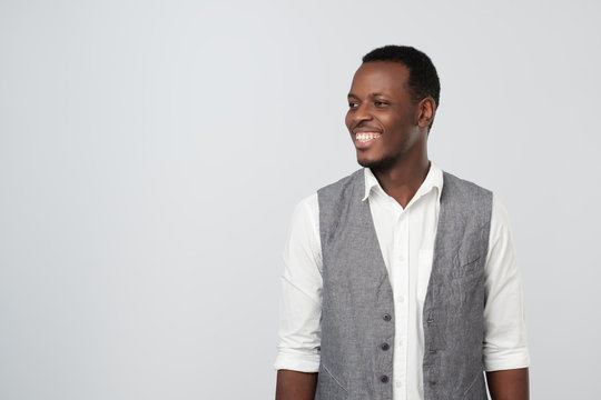 Portrait of a happy African American young businessman looking to the left