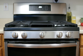 Modern stainless steel gas stove oven in a home.