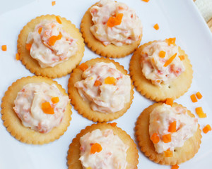 Tasty crackers with cream cheese,carrot.Healthy snacks, on dish