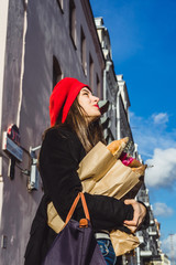Frenchwoman with baguettes on the street in beret