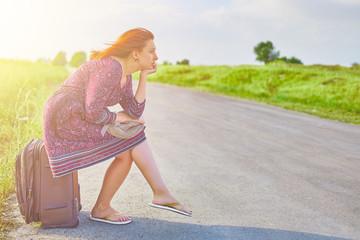 Woman sits on baggage