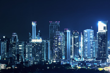 landscape scenery of buildings and skycrapers in the central business area of Bangkok city at night