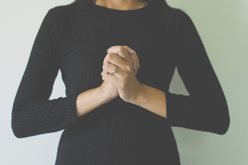 Woman with hand in praying position,Female prayer hands clasped together