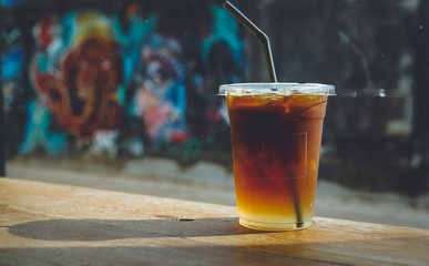 close up Iced americano with blur interior cafe background
