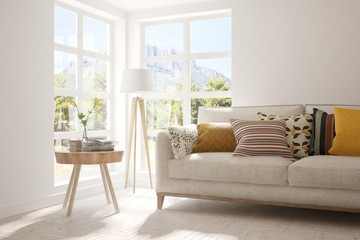 White stylish minimalist room with sofa and smmer landscape in window. Scandinavian interior design. 3D illustration