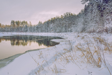 Red rocks and river Gauja. Many snow at winter 2019. Travel photo.