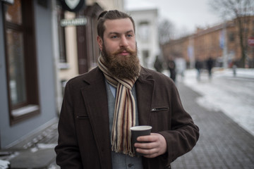 man with a beard drinking coffee