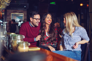 Friends got together after work in a bar for a few drinks. - Image