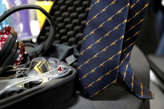 A necktie with a rifle pattern is displayed in the Pack'n Heat booth during the SHOT (Shooting, Hunting, Outdoor Trade) Show in Las Vegas