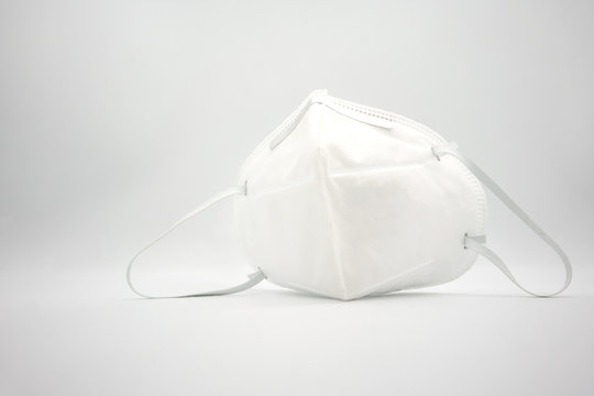 Disposal 3D air pollution or dust mask with adjustable metal noseclip isolated on white back ground