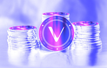 Vechain (VEN) digital crypto currency. Stack of coins. Cyber money.