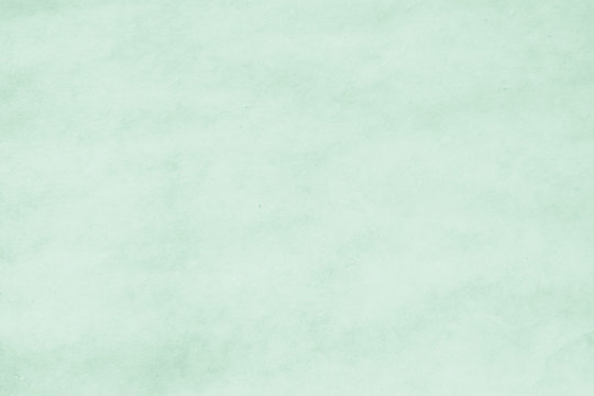 Water color paper texture background in light fresh green .