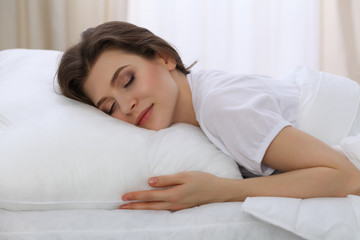 Beautiful young woman sleeping while lying in her bed. Concept of pleasant and rest reinstatement for active life