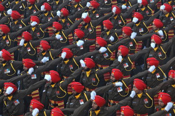 Indian soldiers march during the full dress rehearsal for the Republic Day parade in New Delhi,