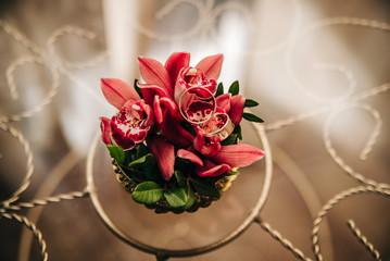 wedding rings lie on delicate red flowers