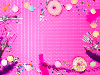 pink carnival effect background with various carnival utensils