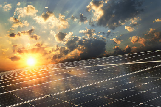 solar panel with sunset background. concept clean energy