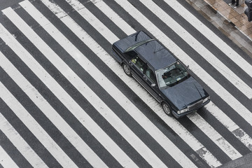 Tokyo Crosswalk Scene on the Rainy Day from above